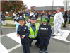 Officer smiling with two children in police costumes