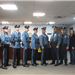 Ten officers standing in a line in an office