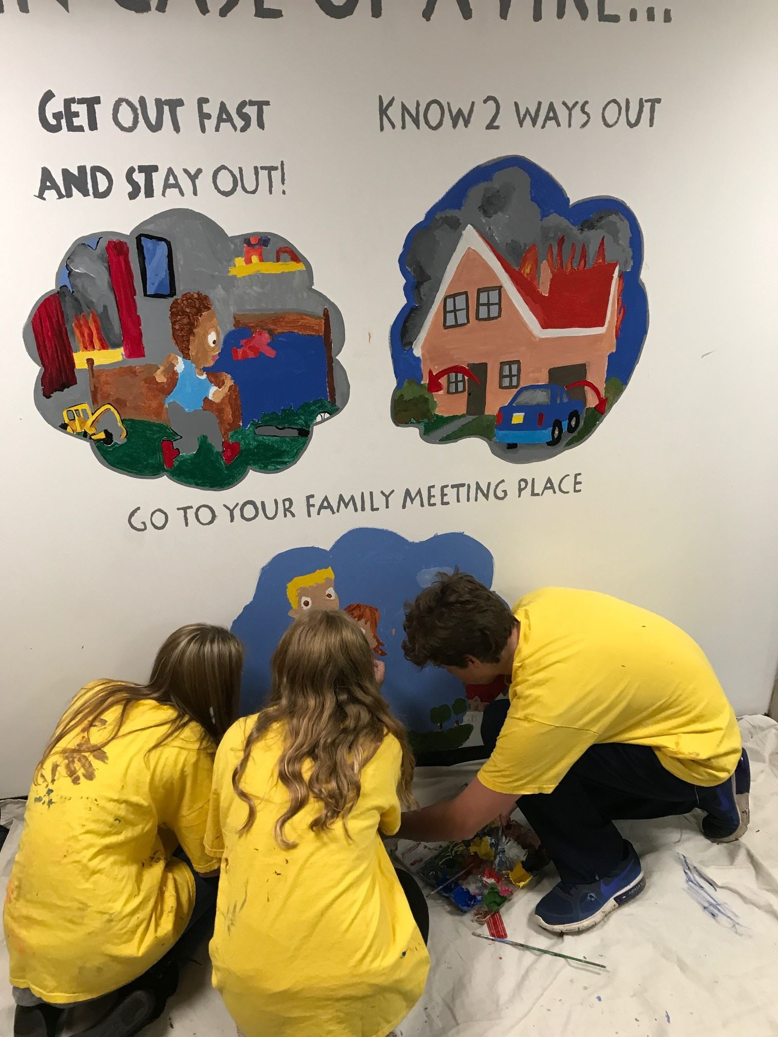 Art Students from The Cambridge School painint the fire safety mural in the Health Department Lobby