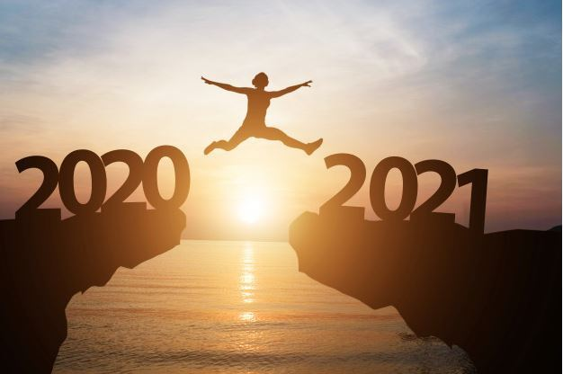 Image of a person jumping from one hill marked 2020 to another marked 2021, with a sunset and an oce